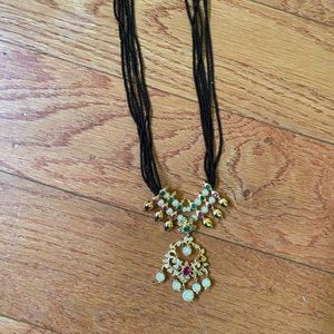 Black beads with gold stone pendant